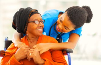 caregiver hugs her patient