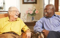 two elderly men smiling