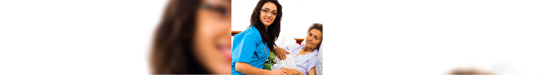 nurse taking care of an elderly woman in bed